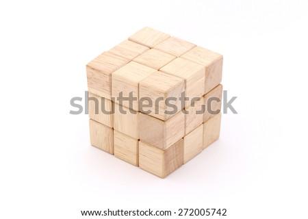 Cube puzzle wooden blocks isolated on white background - stock photo