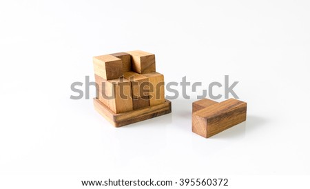 Cube puzzle wooden blocks isolated on white or empty background. Slightly de-focused and close-up shot. Copy space.  - stock photo