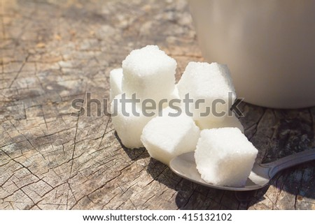 Cube sugar on wooden table  - stock photo