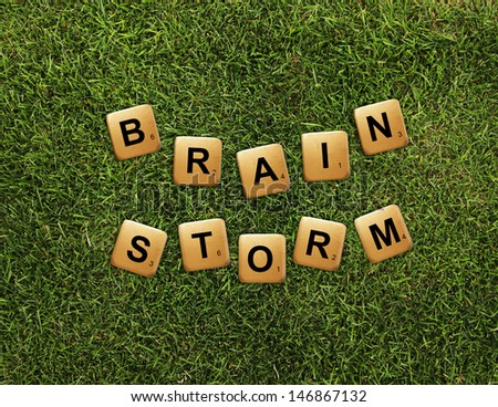 cubes crossword brainstorm on grass - stock photo