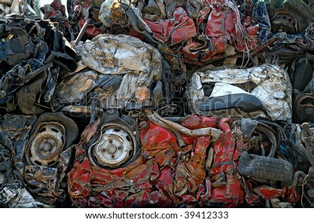 Cubes of crushed cars for metal recycling - stock photo