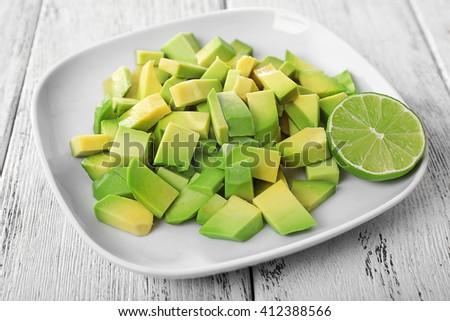 Cubes of fresh avocado on plate closeup - stock photo
