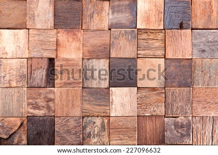 Cubes of old boards boats collected in tile - stock photo