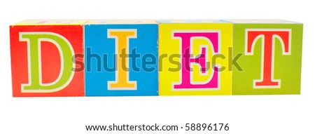 cubes with letters in front of a white background - diet