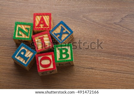 Cubes with letters on wood background