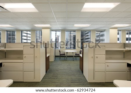 Cubicles and meeting area in a downtown office building - stock photo