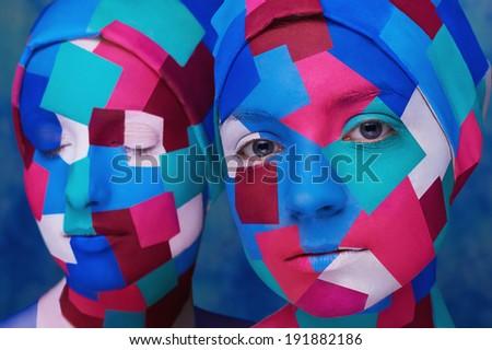 cubism styled ladies wiyh angular face-art isolated on blue background - stock photo