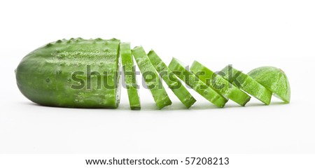 Cucumber and slices isolated over white background