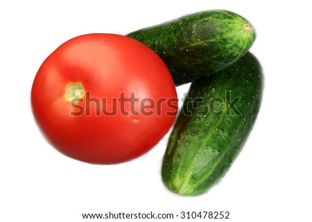 Cucumber and tomato it is isolated on a white background - stock photo