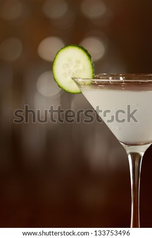 cucumber martini served on a bar top garnished with a cucumber slice - stock photo