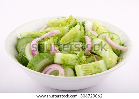 Cucumber salad with  onions.