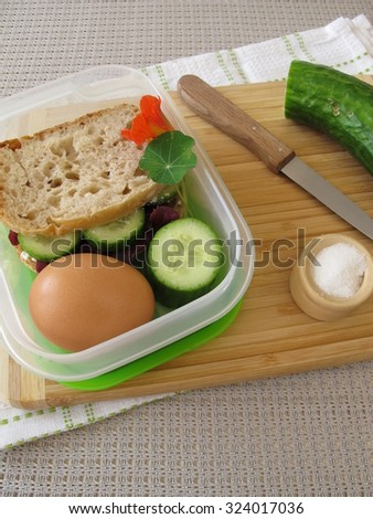 Cucumber sandwich in lunch box for take away - stock photo