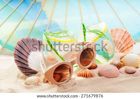 Cucumber water on the beach - stock photo