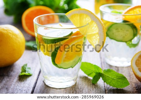 Cucumber water with citruses - stock photo