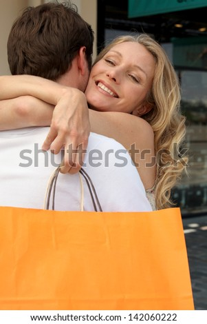 Cuddle with shopping bag - stock photo