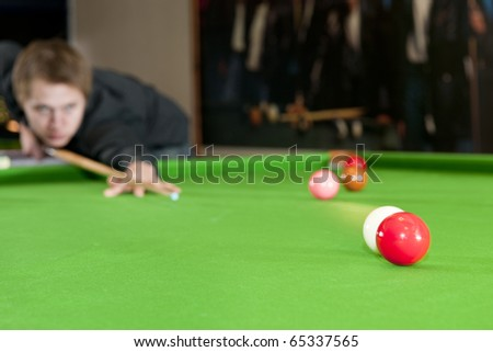 Cue ball colliding with a red ball on a snooker table