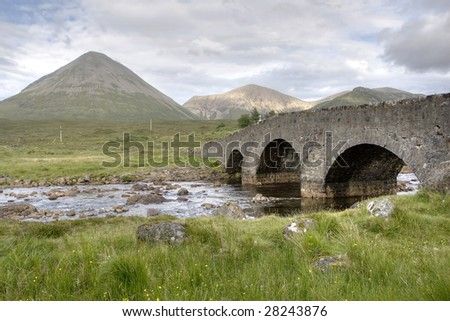 Cuillin area in Highland Scotland UK with an ancient bridge and mountains in HDR - stock photo