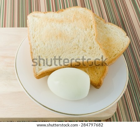 Cuisine and Food, Delicious Homemade Brown Toast with Boiled Eggs in A White Plate for Breakfast. - stock photo