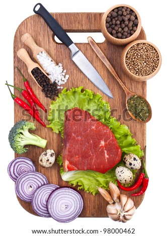 Culinary background with fresh vegetables on cutting board - stock photo