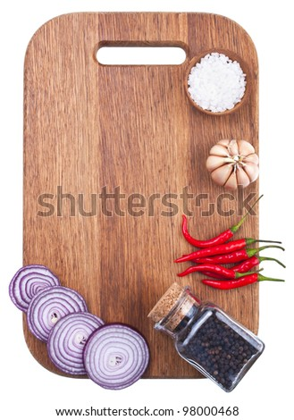 Culinary background with fresh vegetables on cutting board
