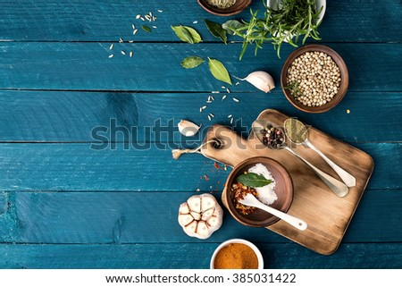 culinary background with spices on wooden table - stock photo