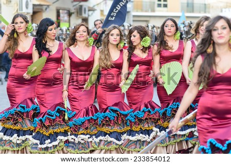 CULLAR, SPAIN - APRIL 26: Unidentified participants at Fiesta Moros and Cristianos, participate in a costume parade on the streets of Cullar, Granada April 26, 2014 - stock photo