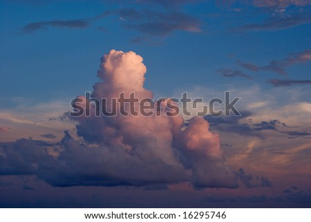 Cumulus Clouds Over the Ocean at Sunset - stock photo