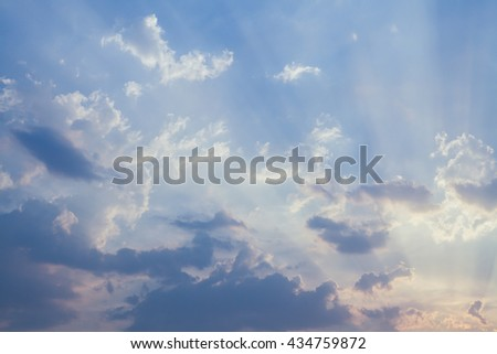 Cumulus sunset sky clouds with sun setting down background  - stock photo
