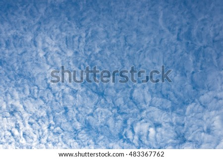 cumulus type white clouds over blue, open sky, background, horizontal