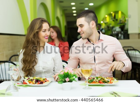 Cuople having a dinner at the restaurant - stock photo