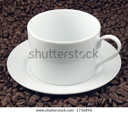 Cup and beans - stock photo