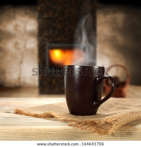 cup and fireplace  - stock photo