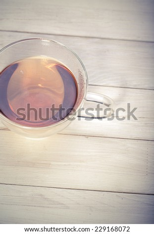 Cup and teapot of herbal tea with fresh mint  - stock photo