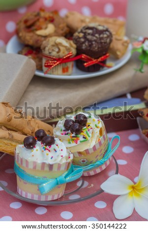 Cup cake and cookie - stock photo