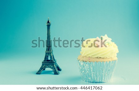 Cup cake with Eifel model vintage background - stock photo