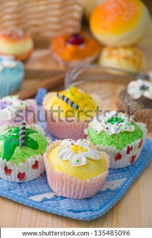 cup cakes with a lot of bread pastry background - stock photo
