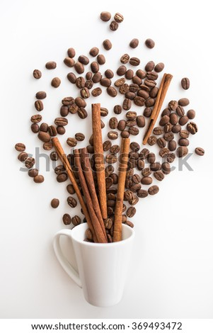 cup filled coffee beans with chocolate and orange  - stock photo