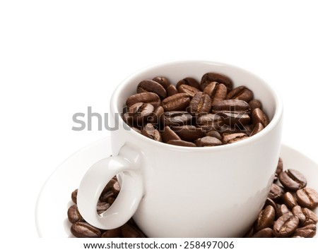 Cup filled with coffee beam's - stock photo