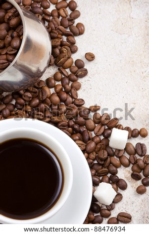 cup full of coffee drink on roasted beans as  background - stock photo