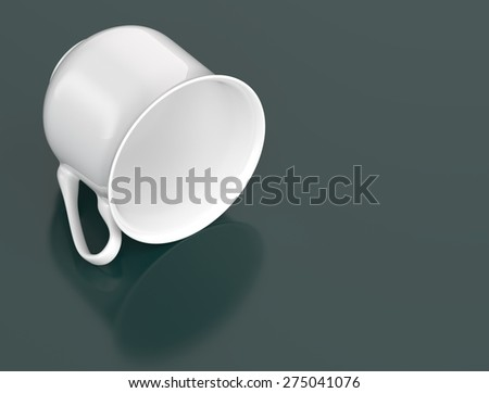 Cup lying on its side on a dark background - stock photo