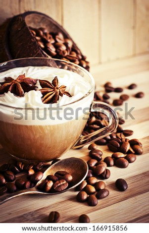 Cup of aromatic coffee and coffee beanes. Selective focus - stock photo