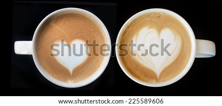 Cup of art cappuccino coffee heart symbol on top view - stock photo