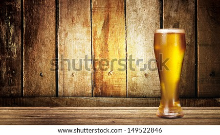 cup of beer on wood