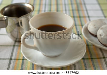 Cup of black coffee and cake on a plate - stock photo