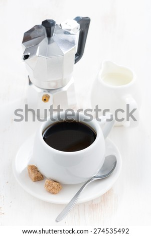 cup of black coffee, cream and coffeemaker, vertical - stock photo