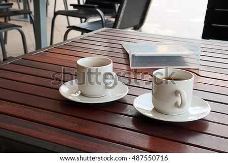 cup of black coffee on the wooden table outdoor cafe