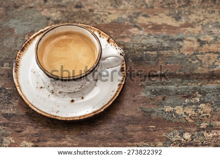 Cup of black coffee on wooden background. Top view - stock photo