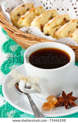 Cup of black coffee with spices and fruitcake.