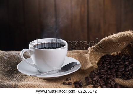 cup of black coffee with wood background - stock photo
