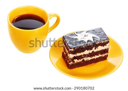Cup of black tea and chocolate cake with spoon on orange plate isolated on a white background - stock photo